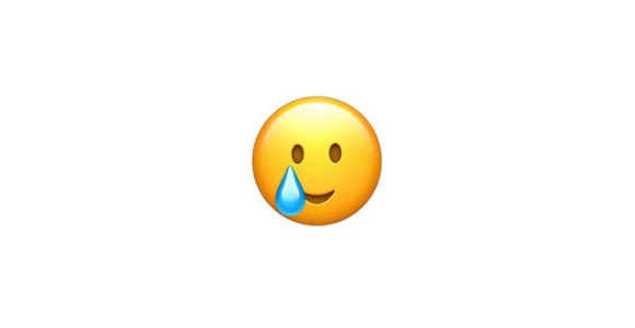 涙のスマイル顔 絵文字